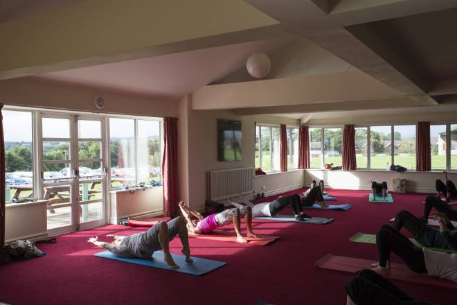 Pilates class in the A.W. Jenkinson Suite